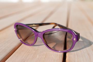 Purple Sunglasses on deck