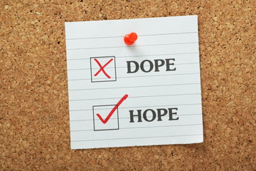Hope Not Dope tick boxes on a cork notice board