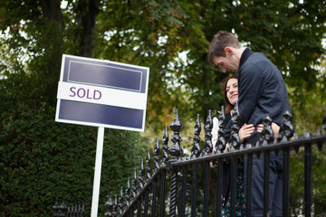young couple celebrate getting the keys to their new home