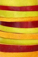 Close up of mixed slices of fruit in a row