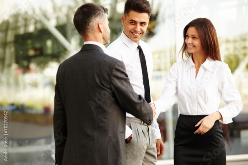 Business Team.  People shake hands communicating with each other - 70270542