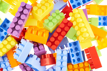 Pile of colorful toy construction bricks
