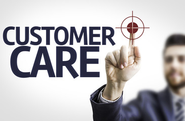 Business man pointing the text: Customer Care