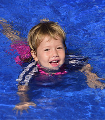 Swimming lessons: Cute baby girl in the pool