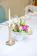 Table set for an event party or wedding reception with candle an