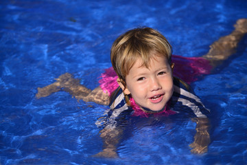 Swimming lessons: Cute baby girl n the pool