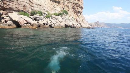 Girl jumpings in sea