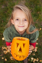 Autumn portrait with a Halloween pumpkin jack-o-lantern