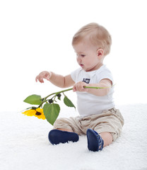 Baby boy with sunflower