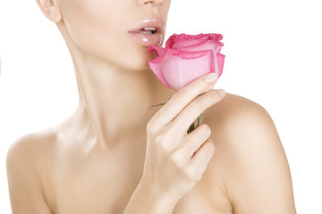 Beauty woman holding pink rose, Close-up