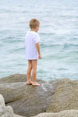 Beautiful kid playing as explorer