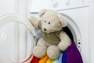 Washing machine, toy and colorful laundry to wash