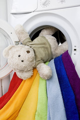 Delicate wash: Washing machine, toy and colorful laundry to wash
