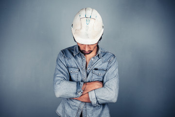 Blue collar worker with arms crossed