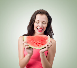Young girl with piece of watermelon
