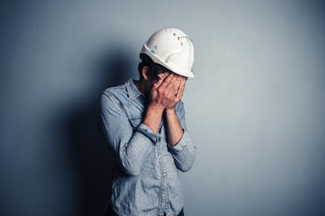 Upset blue collar worker