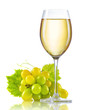 Glass of white wine and a bunch of ripe grapes isolated