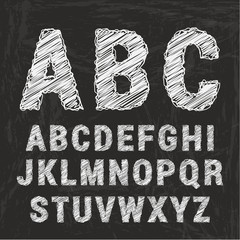 Chalk alphabet on black background.
