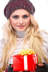 A photo of beautiful girl is in winter clothes with gift