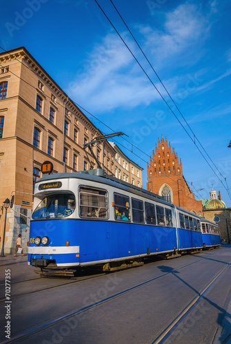 Classic blue tram in old town in Krakow, Poland