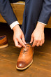 canvas print picture - Groom ties shoes