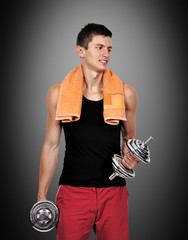 muscular guy holding a dumbbells