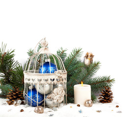Blue and silver christmas balls in a cage on the background of f