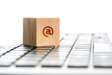 Wooden Block with At Symbol on Computer Keyboard