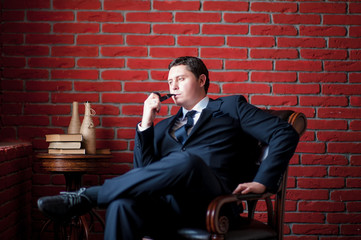 pensive businessman sitting on a chair