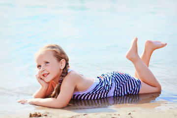 Young girl posing for the camera on shore