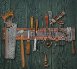 vintage woodworking tools on a wall