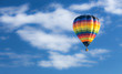canvas print picture - Hot air balloon over blue sky