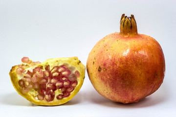 fresh pomegranate on white background