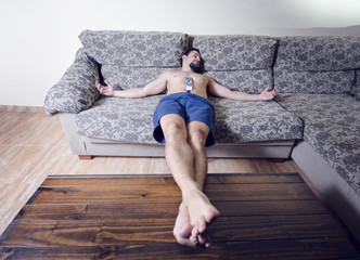 Man resting in sofa like jesus