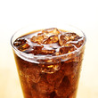 ice cold cola in glass cup