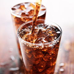 soft drink being poured into glass