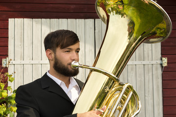 Male musician playing tuba