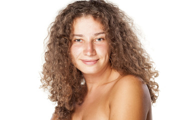 smiling young woman without make-up and curly hair