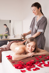 Woman enjoying Ayurveda oil massage in spa