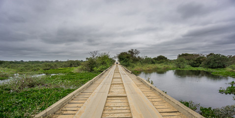 Transpantaneira Road with wooden bridge and car in Panantal