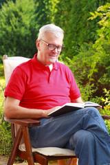 Senior man reading at garden