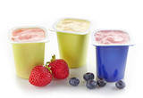 various plastic yogurt pots
