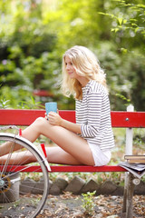 Attractive young woman with bicycle