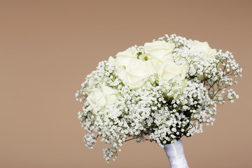 Wedding bouquet against studio background.