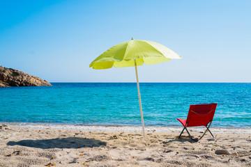 Beach umbrella and lounge chair