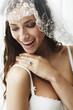 Young bride in wedding veil, studio shot .