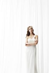 Young bride in wedding dress, studio shot .