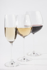 Three glasses with red and white wine