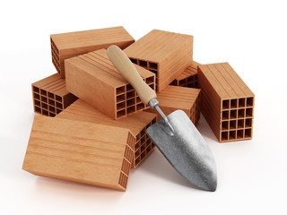 Bricks and hand shovel isolated on white