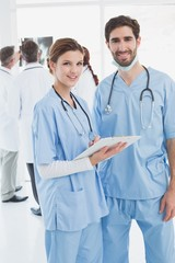 Nurses holding a file together